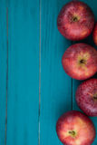 Farm fresh organic red autumn apples on wooden retro blue table Stock Photography