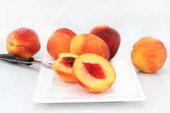 Farm fresh peaches cut and whole Stock Photography