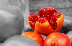 Farm Fresh Pomegranates for Sale:Selective coloring Stock Image