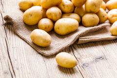 Farm fresh  potatoes on a hessian sack Royalty Free Stock Photography