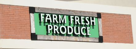 Farm Fresh Produce Market Sign. Farm fresh produce is often fruits and vegetables  that are sold or served fresh, and are natural and organic Stock Image