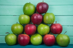 Farm fresh pyramid of organic red and green autumn apples on woo Royalty Free Stock Image