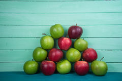 Farm fresh pyramid of organic red and green autumn apples on woo Royalty Free Stock Images
