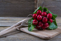 Farm fresh radish. On rustic wooden board Royalty Free Stock Photos