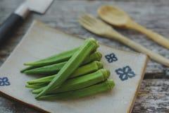 Raw okra. Farm fresh raw okra on wooden rustic table Royalty Free Stock Photo