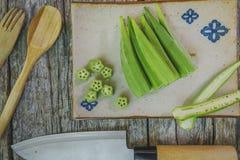 Raw okra. Farm fresh raw okra on wooden rustic table Stock Image