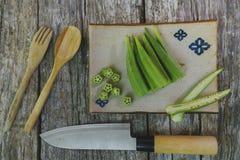 Raw okra. Farm fresh raw okra on wooden rustic table Stock Photos