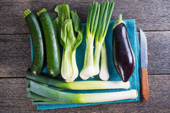 Farm fresh spring vegetables on board from above Royalty Free Stock Photos