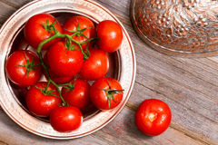 Farm fresh tomatoes in a copper dish Stock Images