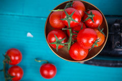 Farm fresh tomatoes on vintage scale Royalty Free Stock Images