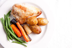 Farm fresh vegetables, roasted chicken and fingerling potato Stock Photography