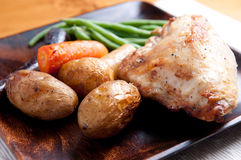 Farm fresh vegetables and roasted chicken and fingerling potato Stock Images