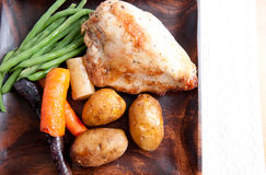 Farm fresh vegetables with roasted chicken and fingerling potato Stock Photography
