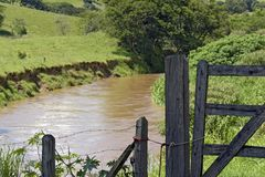 Farm gate with brook behind Royalty Free Stock Images