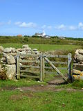 Field Gate and lighthouse Stock Photo