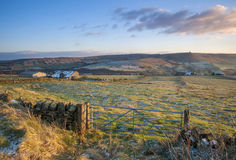 Farm gate and fields in yorkshire in winter. A farmhouse in the yorshire dales on a frosty day Stock Images