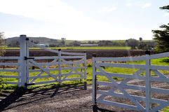 Farm gate. Rural scene of an open farm gate in the field Royalty Free Stock Photography