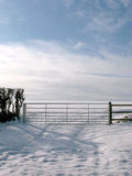 A Farm Gate Snowfall Landscape Scene. Stock Images