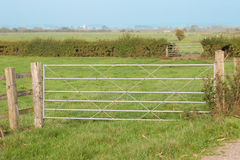Farm Gates. Metal Farm gates and open Fields Royalty Free Stock Images