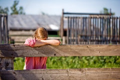 Farm Girl. A farm girl resting on the fence Stock Images