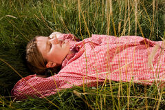 Farm Girl. A farm girl relaxing in the grass Stock Images