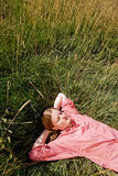 Farm Girl. A country farm girl relaxing in the grass Stock Image