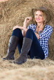 Farm girl daydreaming. Beautiful young farm girl daydreaming in barn Stock Photos