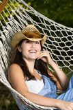 Farm girl in a hammock Stock Image