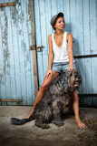 Farm girl with her dog. Stock Photos
