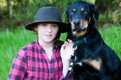 Farm girl with her dog Stock Image