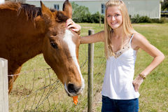 Farm Girl & Horse. Beautiful teen girl on the farm with her horse royalty free stock photo