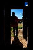Farm Girl Silhouette. A farm girl standing in a doorway of a barn Royalty Free Stock Photo