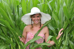 Farm girl standing in a corn field Stock Photo