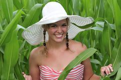 Farm girl standing in a corn field Royalty Free Stock Photo