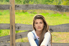 Farm Girl Standing Next To Old Wooden Fence Royalty Free Stock Image