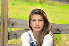 Farm Girl Standing Next To Old Wooden Fence Royalty Free Stock Photo