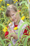 Farm girl in the sunflower patch royalty free stock photography