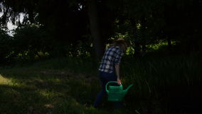 Farm girl watering-can Stock Photos