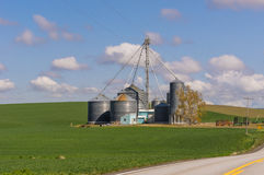 Farm with grain storage silos Royalty Free Stock Photo