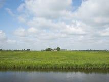 Farm in green grassy countryside near Leeuwarden in Friesland Stock Photos