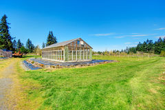 Farm with greenhouse Stock Image