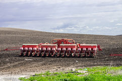 Farm harvester in the field sowing seeds Stock Photos
