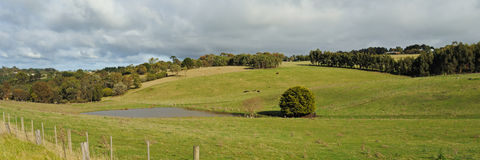 Farm on hills panorama Royalty Free Stock Image