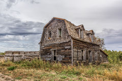 Farm home. Abandoned farm home with haybales Royalty Free Stock Photo