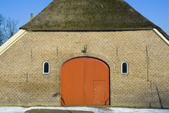 Farm house. Front view of a typical Dutch  farm house during winter Royalty Free Stock Photos