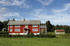 Farm House. Traditional Norewian farm house with barn and flag pole stock images