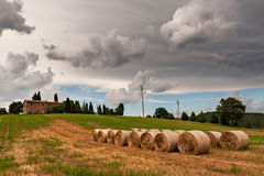 Farm house. In Tuscany, italy, with straw rolls Stock Image