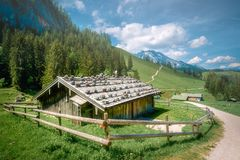 Farm house in Bavarian Alps, Berchtesgaden. Farm house in Bavarian Alps at Berchtesgaden National Park, Germany, Europe. . Clipping path of sky stock image