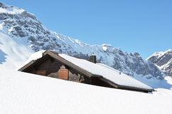 Farm house buried under snow Stock Photos