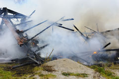Farm house burns down by fire Royalty Free Stock Image